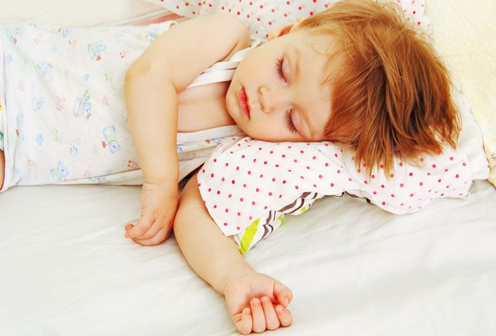 child-sleeping-in-bed